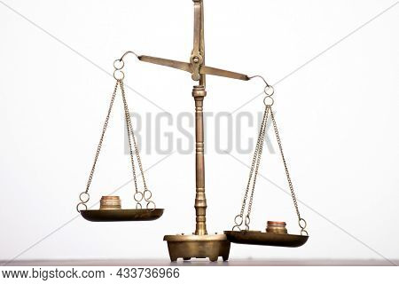 Balance scale with coin stacks. Money management, time value of money and saving money concept.