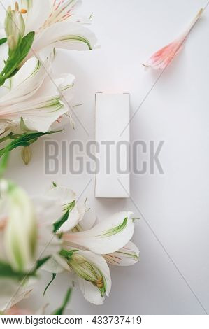 A White Box Of Moisturizer, Perfume Or Lipstick And A Bouquet Of White Alstroemeria - Flatley
