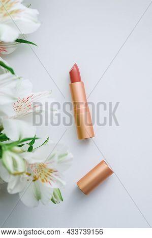 Pink Matte Lipstick In A Golden Metal Case And White Alstroemeria Close-up - Flatley