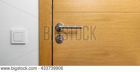 Brown Wooden Door With Metal Handle. Copy Space