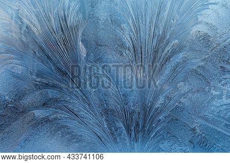 Frosty Pattern Of Frost On Glass Close-up. Horizontal Photo.