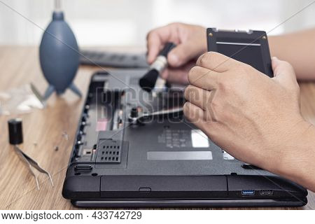Computer Literacy Repair Men Hands Holding Hard Disk Of Laptop For Check Repair And Cleaning With Co