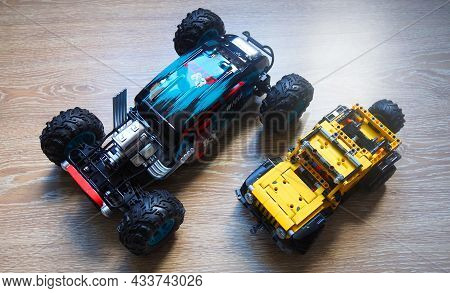 A Radio-controlled Car With A Remote Control. Close-up And Details Of A Radio-controlled Car.