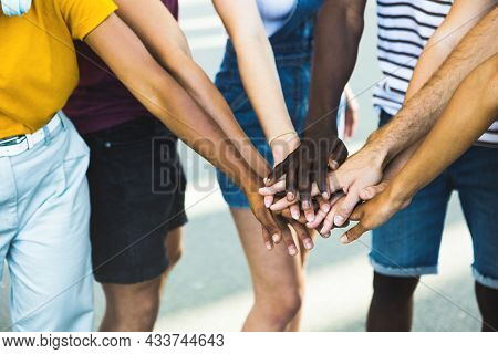 Close Up Multi Ethnic Group Of Young Students Stacking Hands Together - Millennial People Celebratin
