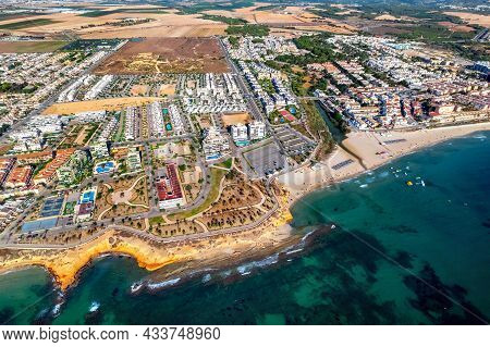 Playa Mil Palmeras Drone Point Of View. Aerial Photography Sandy Beach And Mediterranean Sea At Sunn