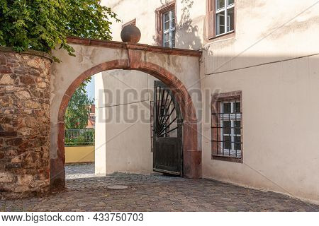 Archway With Sandstone Elements In The Old Town Of Colditz, Saxony In Germany. Path With Cobblestone