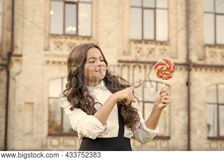 Sugar Diet. Sweet Joy. Happy Kid With Sweet Candy. Happy Childhood. Kid Child Holding Lollipop Candy