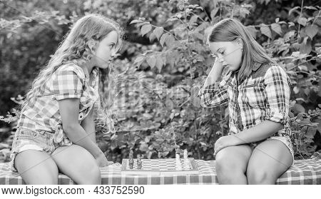 Think Better. Little Girls Play Chess. Sisters Playing Chess. Smart Children. Early Childhood Develo
