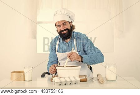 Skilled Baker Use Kitchen Utensils For Cooking. Male Chef In Hat Prepare Healthy Meal. Handsome Man