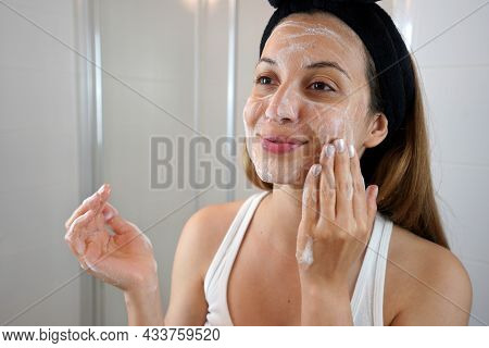 Young Skin Care Routine. Girl Washing Face Foaming Soap Scrubbing Skin. Face Wash Exfoliation Scrub