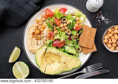 Healthy Salad With Avocado, Hummus And Vegetables