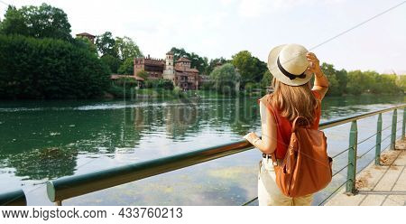 Panoramic Banner View Of Traveler Girl With Backpack And Hat Looking Castle In The Park. Young Woman