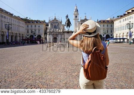 Tourism In Italy. Back View Of Tourist Girl Visiting San Carlo Square In Turin, Italy. Young Female