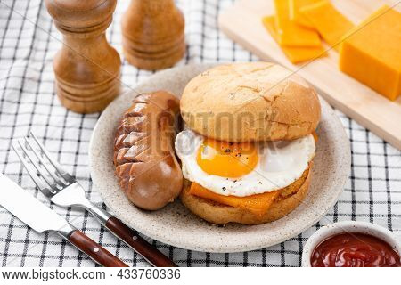 Breakfast Sandwich With Fried Egg, Cheese, Sausage