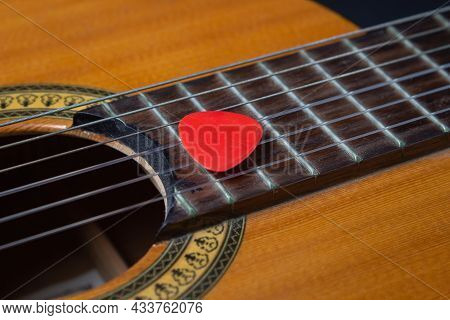 Close-up Of A Guitar Pick On The Strings Of A Classical Guitar. Classical Guitar Music Concept
