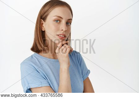 Portrait Of Thoughtful Blond Woman Looking Confident And Ponder Smth, Glancing With Interest, Touchi