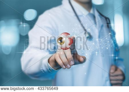 Doctor Ophthalmologist Clicks On A Virtual Computer Screen On A Model Eye.