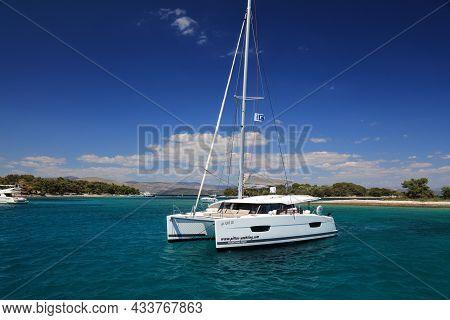 Primosten, Croatia - July 15, 2021: Fountaine-pajot Catamaran Anchored In A Bay On Adriatic Sea. Fou
