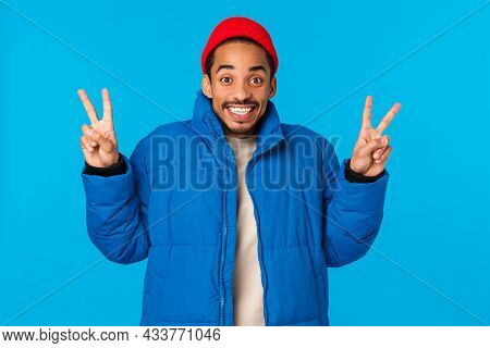 Say Cheeze. Ecstatic Cheerful Young African American Guy Enjoy Winter Holidays, Like Christmas And N