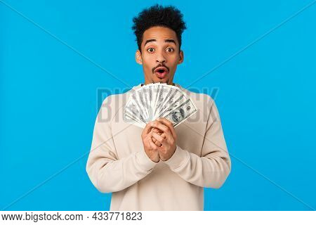 Lottery, Sport Bet And Finance Concept. Amazed And Startled Happy African-american Guy Got Lots Of C