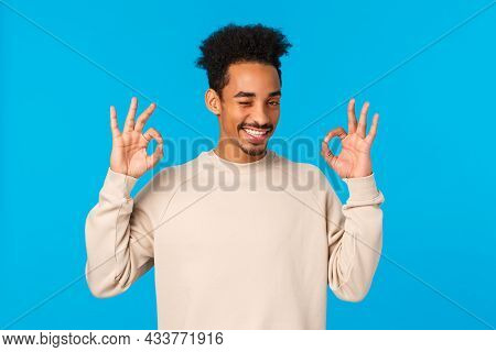 Cheeky And Flirty, Attractive Sly African-american Hipster Guy Checking Out Something Awesome, Showi