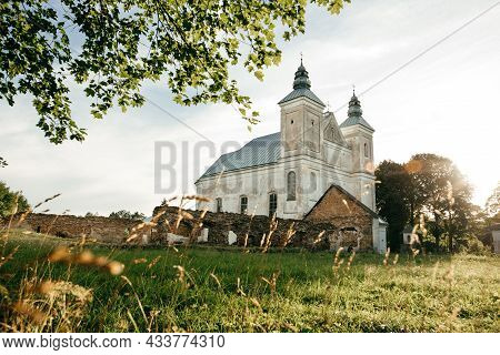 Old Catholic Church At The Sky Background