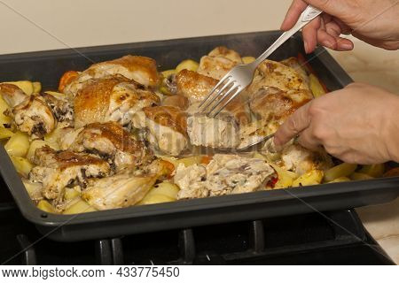 Fried Chicken With Potatoes. Baking Tray With Cooked Chicken, Potatoes, Carrots And Paprika