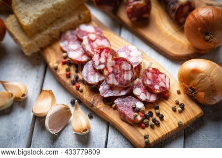 Slices of cured pork meat sausage similar to chorrizo and saucisson