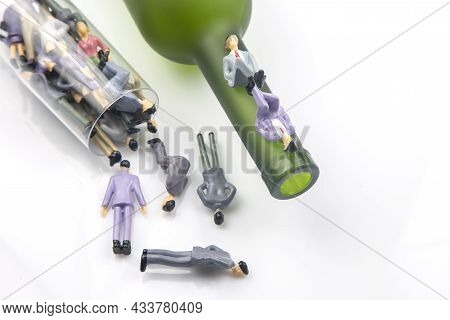 Miniature People. Alcohol Addiction Problem Concept. Alcoholics Are In A Wine Glass Against The Back