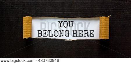 You Belong Here Symbol. Words 'you Belong Here ' Appearing Behind Torn Black Paper. Beautiful Black