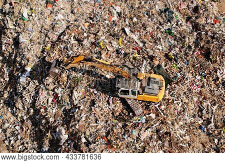 Garbage Dump With Construction Waste. Excavator During Recycling Of Waste At Junk Yard. Trash Dispos