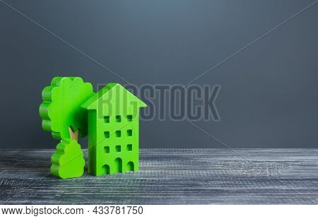 Green Eco House With Trees. Autonomy And Natural Resources Economy. Energy Saving Technologies In Ho