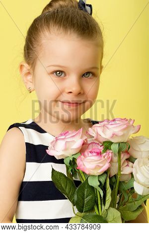 Cute Little Girl In Nice Dress With Bouquet Of Flowers. Half Turned Full Length Portrait Of Pretty L