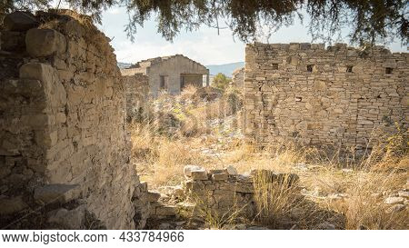 Rural Depopulation. Overgrown Ruins Of Abandoned Traditional Village In Cyprus