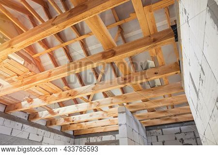 New Construction Of The House. Construction Of A Wooden Roof From Beams, Interior View Of The Roof S
