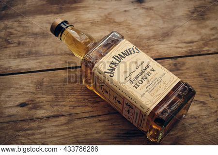 Bottle Of Jack Daniels Honey At Weathered Wooden Table. Illustrative Editorial