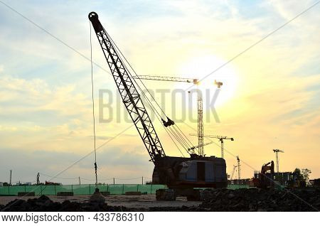 Crawler Crane Or Dragline Excavator With A Heavy Metal Wrecking Ball On A Steel Cable. Wrecking Ball