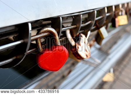 Padlock On Lovers Lock Bridge. Husband And Wife During The Wedding Hung A Padlock On The Fence On Me