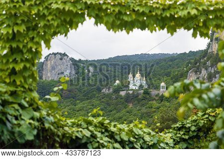 The Church Of The Archangel Michael. View From The Sunny Path Through The Foliage. Crimea. Yalta