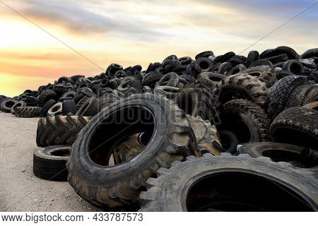Landfill With Old Tires And Tyres For Recycling. Reuse Of The Waste Rubber Tyres. Disposal Of Waste