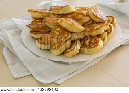 Freshly Baked Pancakes In A White Plate On The Table. Delicious Morning Breakfast With Hot Pancakes.