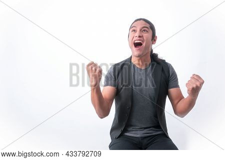 Person With White Background, Man Making Gestures, He Is Happy For A Victory And With Clenched Fists