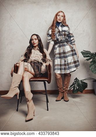 Retro Fashion: Two Beautiful Young Women Indoors. Vintage Portrait Of Gorgeous Girls In Seventies St