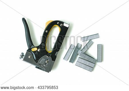 Top View, Construction Stapler And Staples Isolated On White Background. Heavy-duty Steel Staple Gun