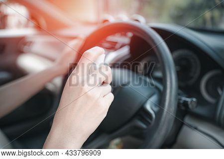 Close Up Hand Women Use Alcohol Spray Clean Steering Wheel And Inside Car Part Cleaning Concept With