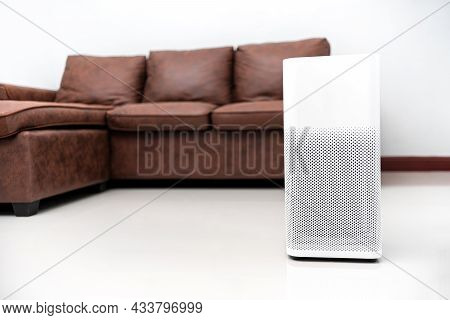 Air Purifier Reduce Dust And The Spread Of Airborne Germs In The Home And Couch On The Cream Colored