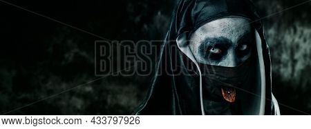 a scary evil nun, in a black and white habit, sticking out her pierced tongue through a hole in her black face mask, in a panoramic format to use as web banner or header