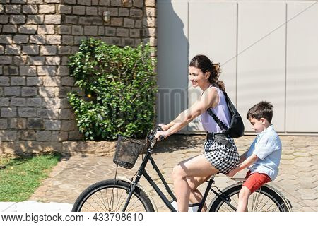Brazilian Mother And Son Relaxing And Riding A Bicycle On A Sunny Morning.