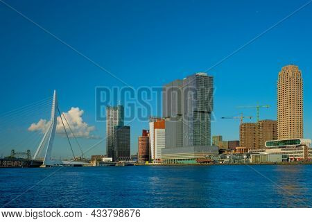 Panorama of Rotterdam skyscrapers skyline and Erasmusbrug bridge view over of Nieuwe Maas river. Rotterdam, the Netherlands