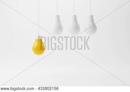 Hanging Light Bulb Yellow Outstanding Among Lightbulb Group. Concept Of Creative Idea And Innovation